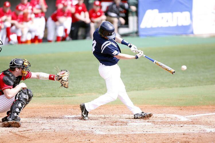 baseball batter hitting the ball
