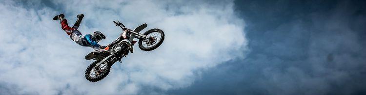 stunt bike with rider half dismounted