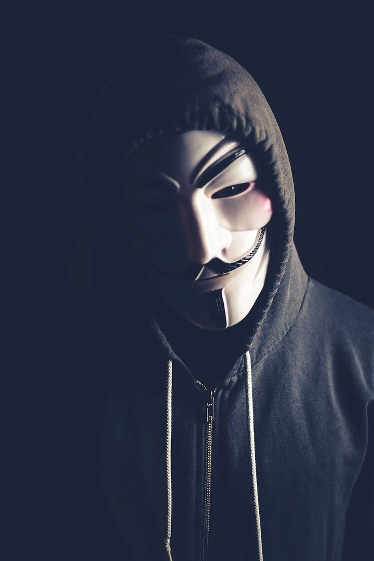 masked man with hooded sweatshirt