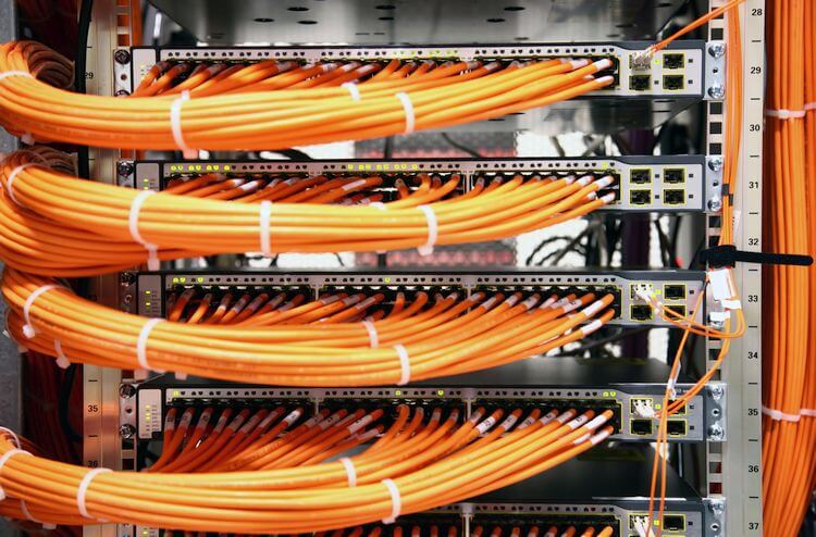 server racks with many orange cables