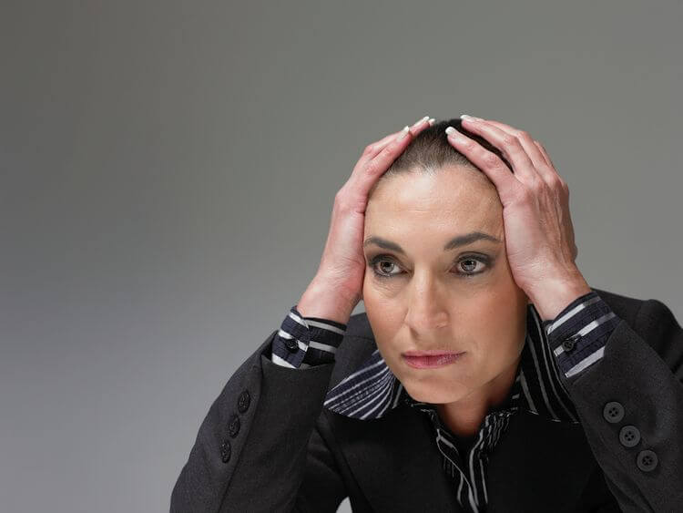 woman with hands on head