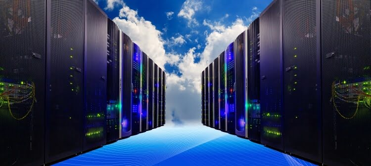 rows of server racks with clouds behind