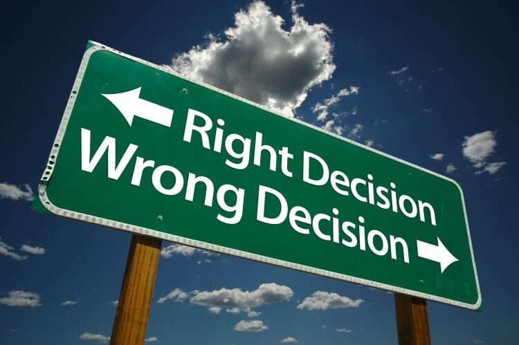 sign pointing to right or wrong decision directions
