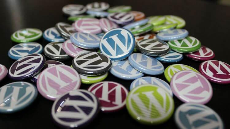 wordpress logo buttons in a pile