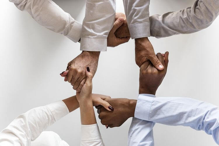 hands interlocked in handshakes