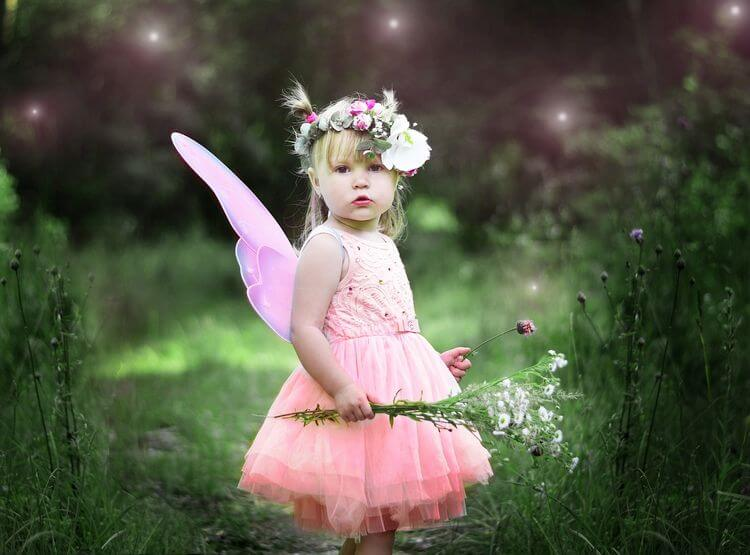 small child in fairy costume