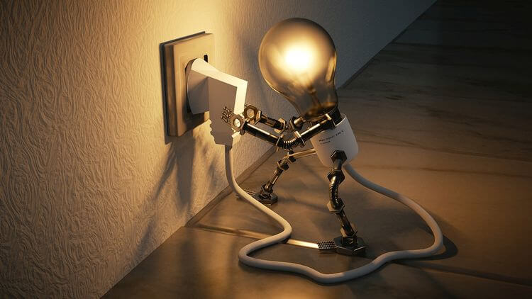 light bulb plugging itself into the wall