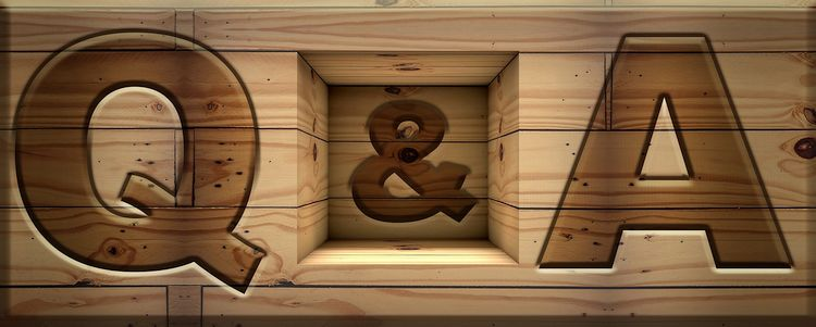 letters q and a carved in wood