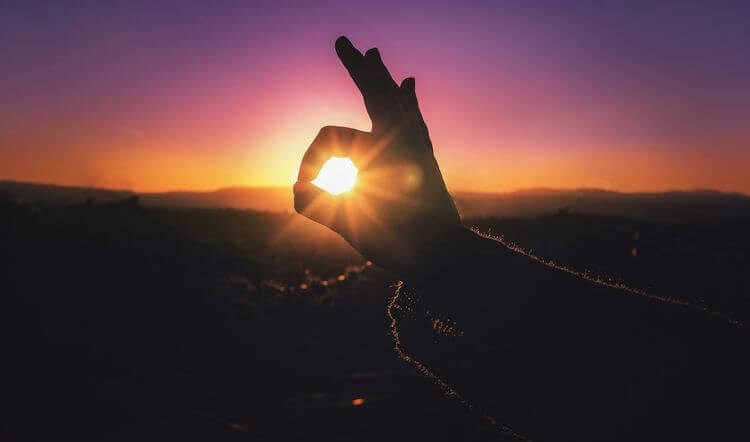 sunset with hand signalling okay