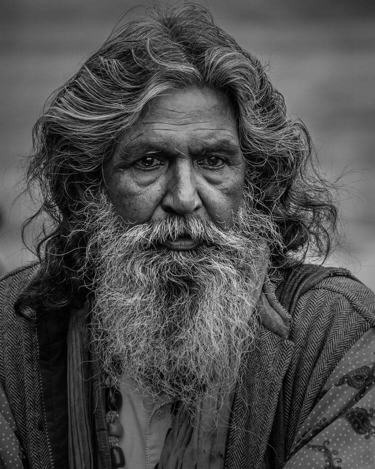 old man with long hair and beard